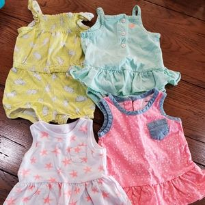 4 total... 2 dresses and 2 rompers Baby Girl